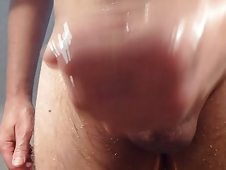 Wanking of my cock oiled and shaved. Close-up on my cumshot