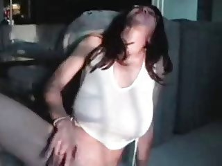 brunette with glasses masturbates to a moaning orgasm