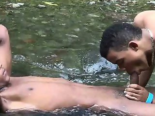 Two young Latinos pack mouths and butts outdoors