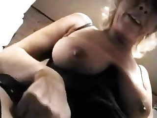 Blonde granny with saggy boobs.