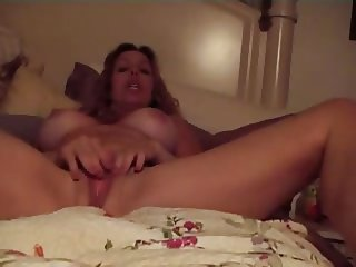 Mature woman fingering her clit
