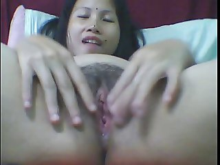Old thai woman plays with herr ass and cunt