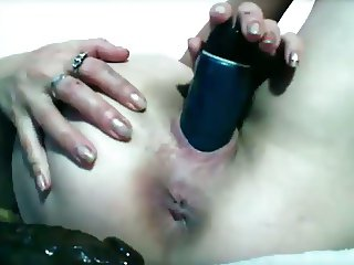Mature dildo fucks ass and pussy, puckers asshole.