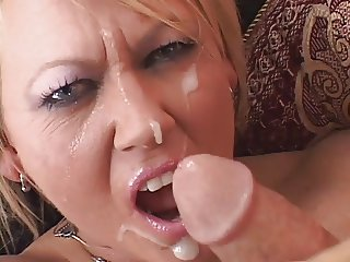 Mature blonde whore grips and pulls on a guys hard thick cock
