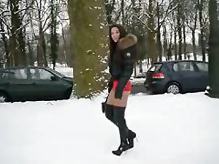 Hooker wearing thigh high boots snow walking