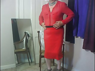 Dee wearing red skirt and blouse