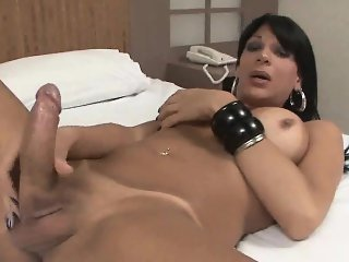 Hot shemale babe Marcella Italy tugs on her penis