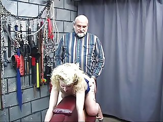 Blonde slave with exposed pussy and tits gets blindfolded