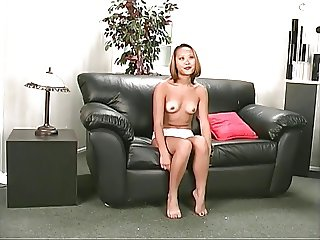 Dirty bitch geting nude in the sofa, then shows her tits and ass