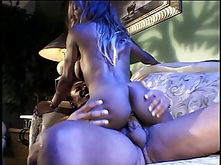 Ebony honey with long hair is fucking on a couch