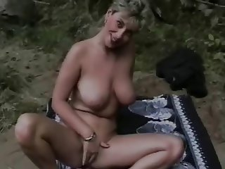 Madame dildoing her asshole