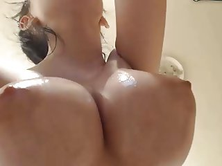 Big oiled puffy tits on dildo riding hottie