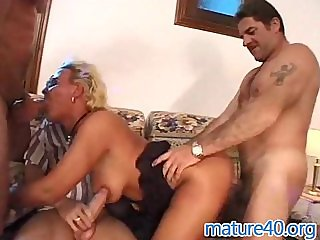 Three men fuck german mature