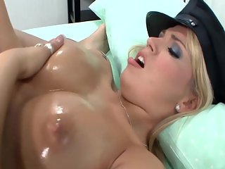 Busty blonde in a cop uniform fucked on a bed