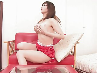 Lusty whore in red fucks herself with a toy