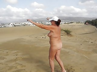 Old whore doing exercises in the dunes