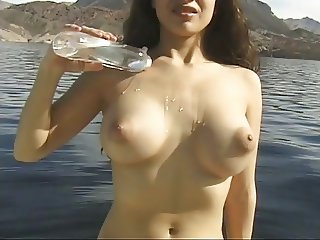 Gorgeous beauty with awesome breasts shows it all in paradise