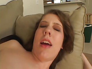 Hot and horny brunette spreads shaved pussy on sofa