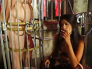 Hot looking mistress Delilah fooling around with her slaves hard cock