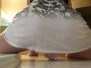 Ponytail Teen riding a Big Jelly Dildo