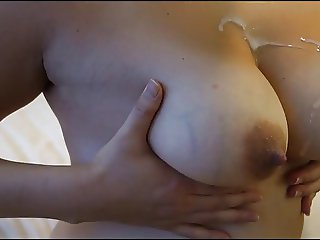 Big nippled tits gets cummed on and she spreads it