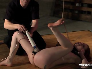 Brunette sex slave has pussy flogged