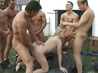 Sexy blonde banged by a bunch of dudes