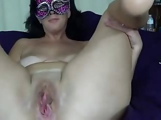 Mature masturbating while wearing mask