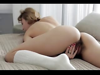 Sexy young babe plays with her hairy pussy