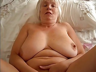 two granny masturbates in the bed