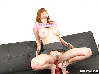 Busty redhead with a long red brutal dildo