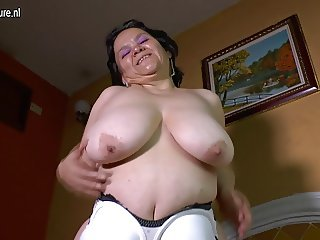 Latin granny with huge saggy tits makes home video
