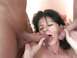Sexy granny fucks two young boys