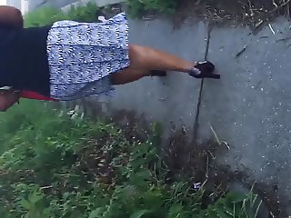 Big MILF booty moving in skirt
