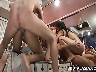 Thai bimbo with a juicy rack rides a fat dick