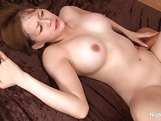 Asian cutie teases the camera before getting fucked