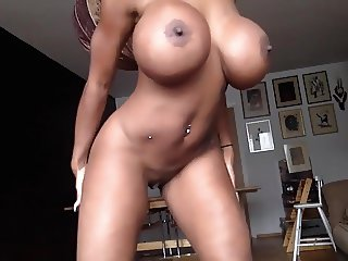 tanned girl shows her new fake boobs