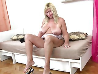 Real granny with saggy tits and hungry pussy