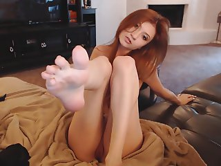 Cute redhead plays with feet & pussy