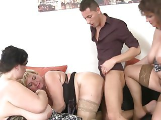 3 Matures fucking with a Young Boy