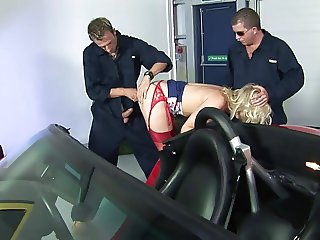 Two car mechanics share one gorgeous blonde babe
