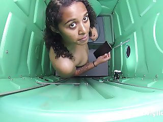 Porta Gloryhole Teen undresses in a Porta Potty