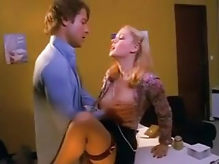 Pretty blonde secretary in stockings fucked on the desk