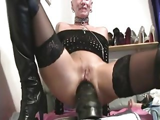 Mature blond German woman plays with a vibrator