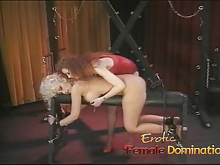Busty dominatrix surrenders herself to a friend in a bdsm