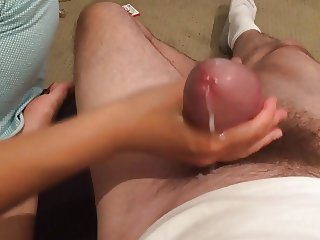 Asian wife obediently jerking of white husband's cock