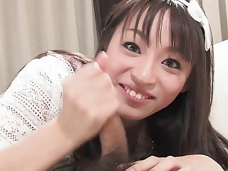 Cute and smiley Japanese girl gives lucky guy blow job