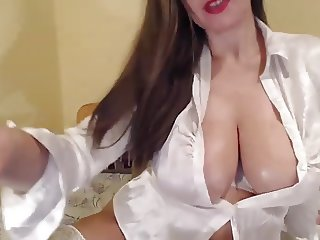 Curvy woman with big boobs in satin blouse