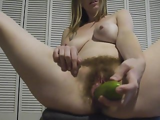 Hairy girl wanks and enjoys a cucumber!