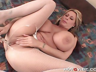 Mature blonde fondles her incredible tits